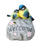 """Birds sitting on stone with """"Welcome"""""""