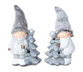 Winterchildren with fabric hat standing