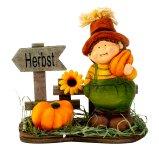 "Harvest figure beside sign ""Herbst"""