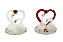 Couple of swans with heart on mirror