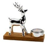 Porcelain deer beside T-light on wooden